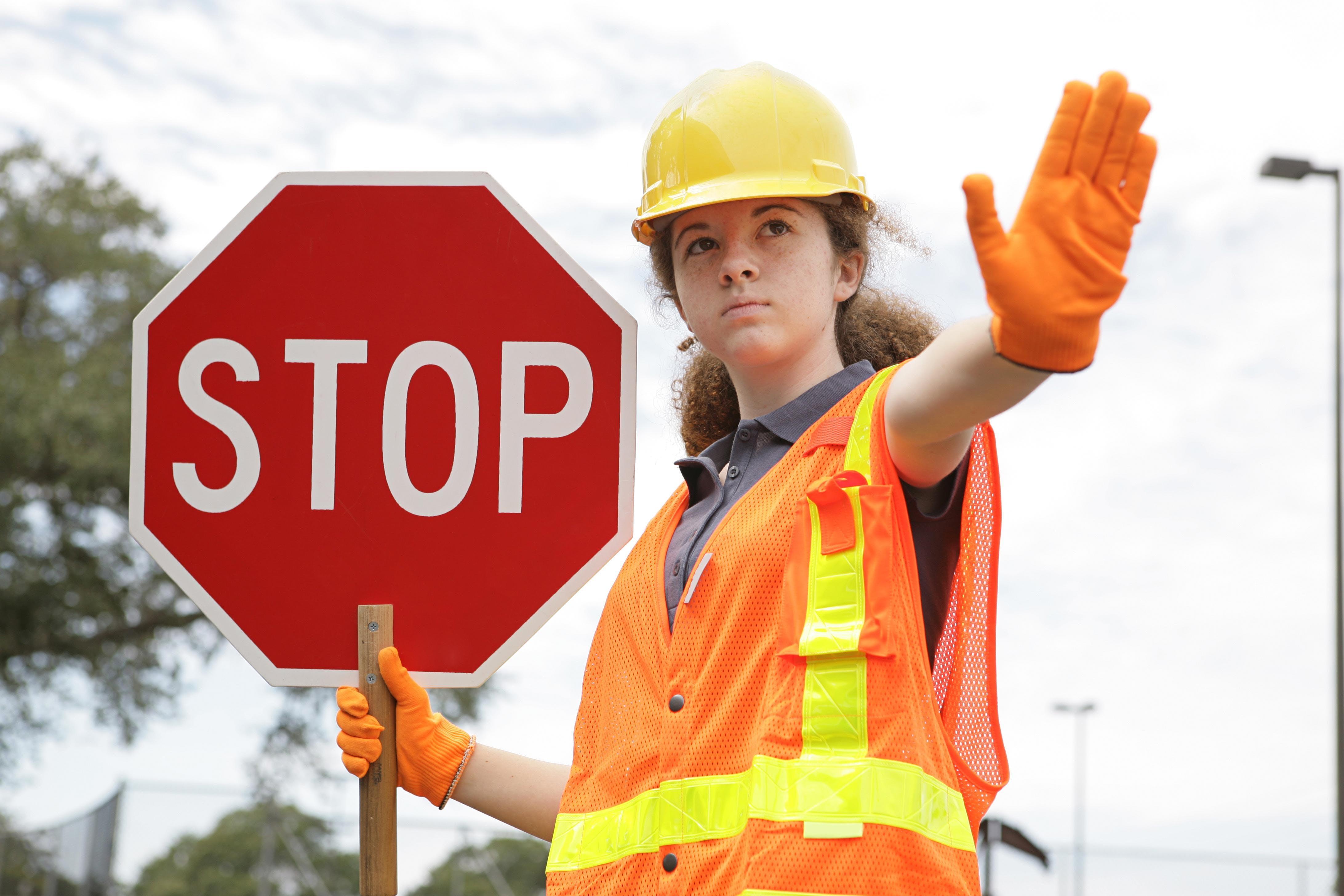 Woman maintaining traffic