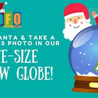 Take a Christmas photo in our life-size snow globe