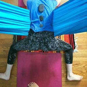 Restorative Aerial Yoga with Hot Stones and Thai Massage