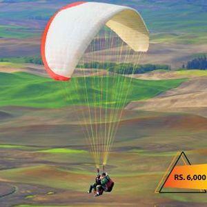 Enjoy Tandem Paragliding in Kallar Kahar with D Memory Makers.